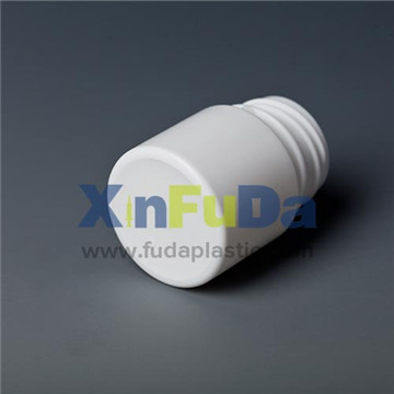 double cap of small plastic medicine bottle