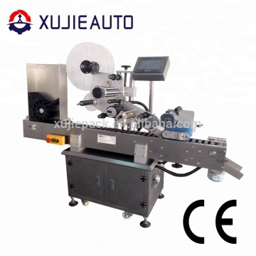 Adhesive automatic labeling machine